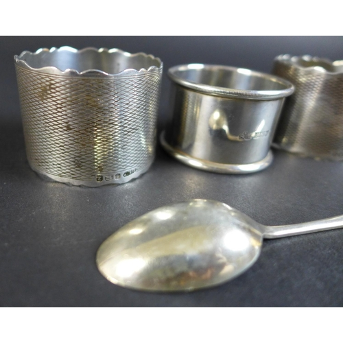 11 - A group of five Edwardian and later silver items, comprising a silver cigarette case with engine tur...