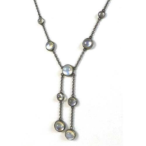 110 - A vintage white metal and moonstone necklace, formed of nine cabochon moonstones, 7mm to 5mm, with b...