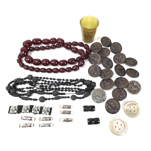 112 - A group of vintage costume jewellery and buttons, comprising a string of forty three cherry amber co...