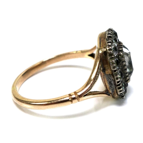 113 - A Georgian gold and paste set ring, with a central old emerald cut paste surrounded by rose cut 'sto...
