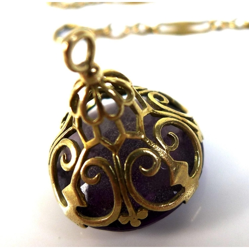 115 - A group of 9ct gold jewellery, comprising an amethyst fob, with pierced scroll mounts, stone 20.2mm ...