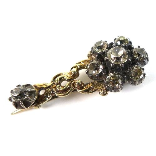117 - An early 19th century yellow metal and diamond flowerhead brooch, central 4mm rose cut stone surroun...
