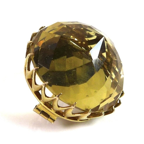 118 - A pineapple cut citrine and yellow metal brooch, the citrine 24mm diameter, 13.2g....