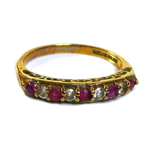120 - A 9ct gold, diamond and ruby nine stone ring, the round cut stones alternately set in a single row, ...