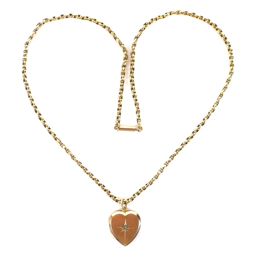 122 - A 9ct gold heart shaped pendant locket, with starburst decoration and a diamond chip to the centre, ...