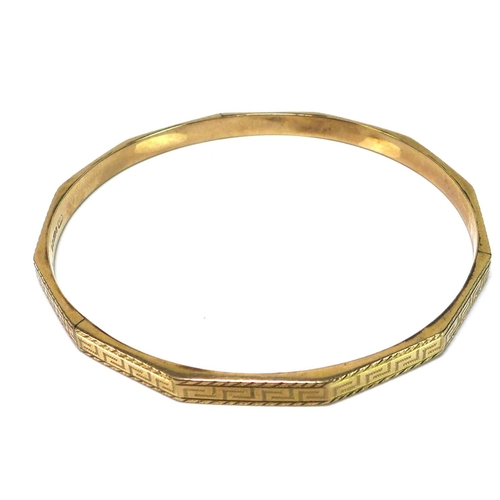 123 - A 9ct gold bangle with faceted sides and Greek key engraved decoration, internal diameter 78.4mm, 10...