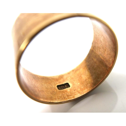 126 - An 18ct gold band, engraved with a calla lily and 'D.H', size R, 6.1g....