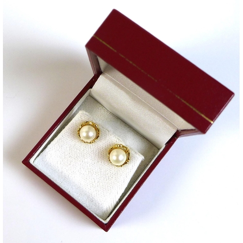 127 - A pair of Hong Kong 18ct gold and pearl stud earrings, of good white lustre, approximately 6.81mm, t...