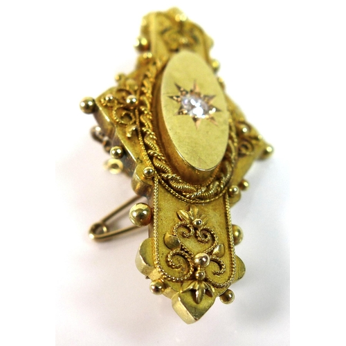 128 - A 19th century 15ct gold gypsy set diamond brooch with safety chain, the single diamond approximatel...
