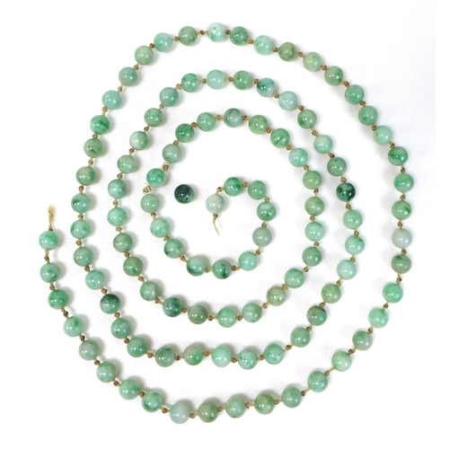 129 - A string of one hundred and seven apple green jade beads, late 19th or early 20th century, a/f strin...
