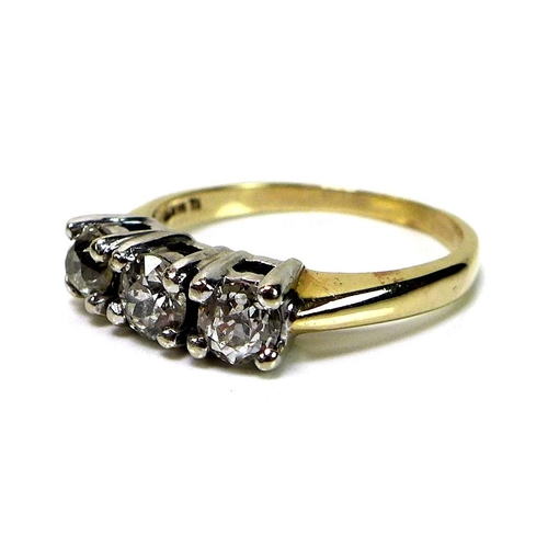 130 - A 14k gold and diamond three stone ring, each stone of approximately 0.33ct, 4mm diameter by 2.66mm,...