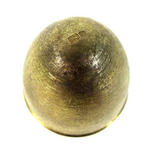 136 - A Stuart Devlin silver gilt 'Surprise' egg, the outer chased surface with plain band to middle, open...