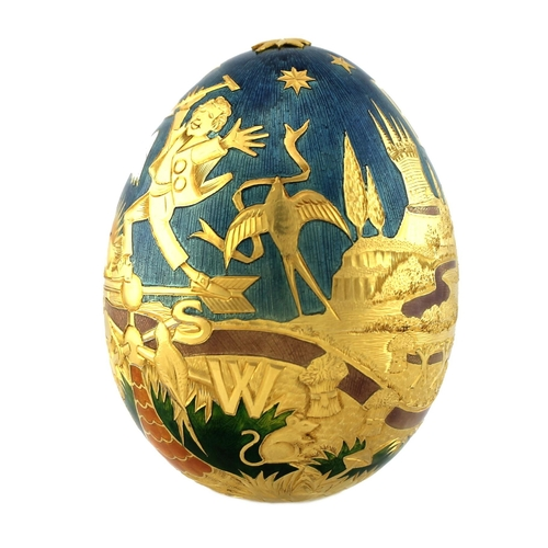 137 - A large 22ct gold Cadbury's 'Conundrum' egg, by Garrard & Co, London, finely engraved and enamelled ...