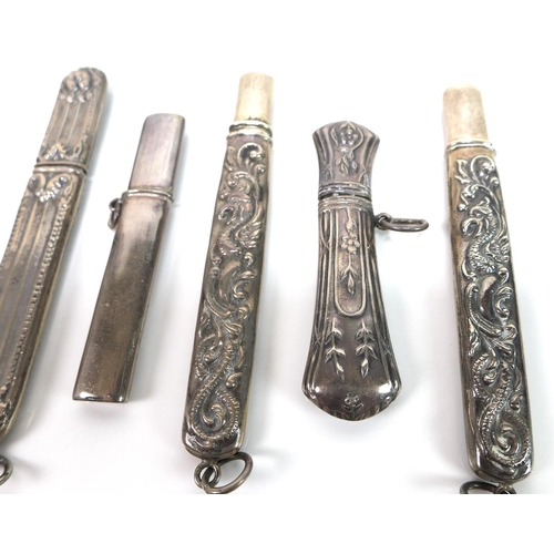 16 - A group of five Edwardian silver pencil holders, four with embossed decoration, one engraved, total ...