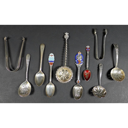 20 - A group of ten silver items, comprising four sifter spoons, largest 15cm, commemorative George V Cor...