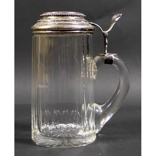 21 - A late 19th century Continental silver mounted cut glass tankard, the stepped circular hinged lid wi...