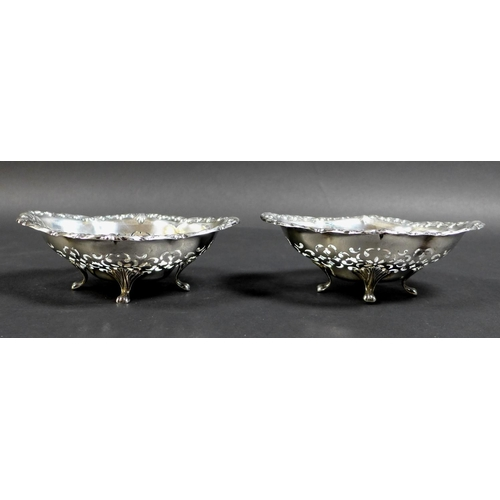 27 - A pair of early 20th century Canadian silver bon bon dishes, of quatrefoil form, each bowl with pier...
