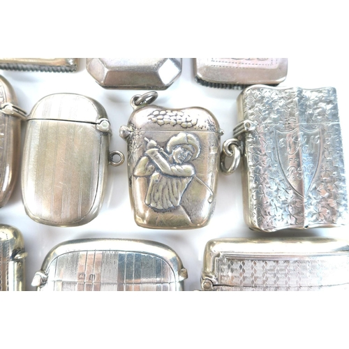 39 - A group of Edwardian silver vesta cases, including one with embossed decoration of a lady golfer in ...