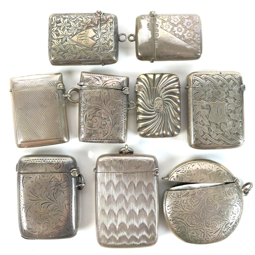 41 - A group of Edwardian silver vesta cases, including a round example with engraved swirling decoration...