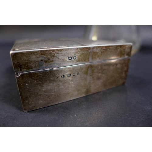 42 - A group of George V and later silver items, comprising two cigarette boxes, both with blank cartouch...