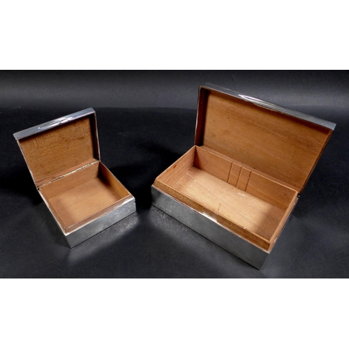 43 - Two George V silver cigarette boxes, comprising a rectangular form box with 'Angus' inscribed to its...