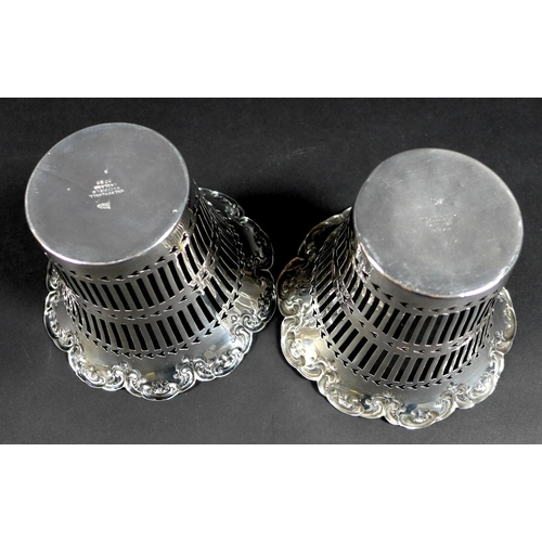 46 - A pair of Edwardian silver baskets, of decagon form with shaped scroll rims and pierced decoration t...