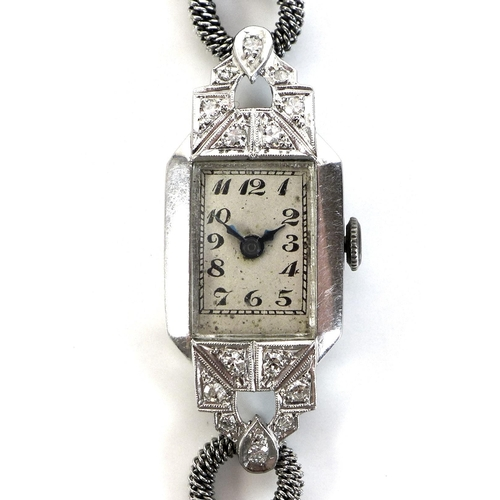 83 - A lady's platinum and diamond set cocktail watch of Art Deco design, set with fourteen diamonds, sil...