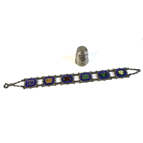 88 - A silver six panel bracelet commemorating Queen Elizabeth II Silver Jubilee, the panels decorated wi...