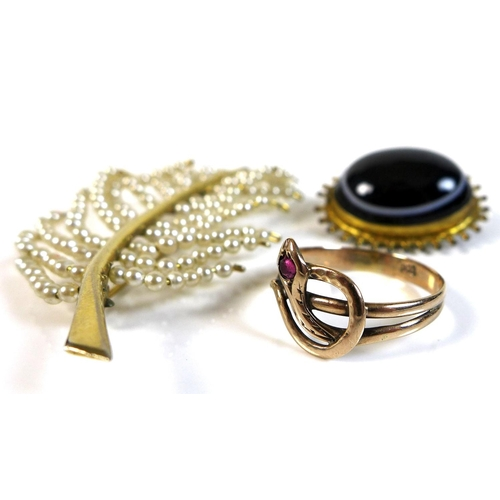92 - An 8ct gold ring, snake's head set with a red stone, size Q, 1.6g, together with a yellow metal broo...