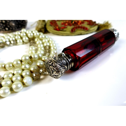 95 - A Victorian faceted cranberry glass and silver mounted double ended scent bottle, one end with screw...