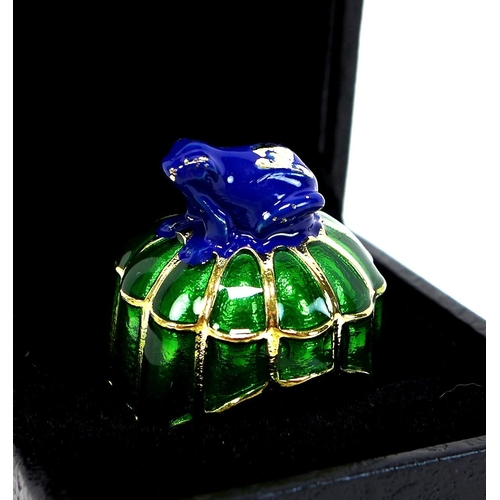 97 - A group of five dress rings, comprising a silver gilt enamelled ring modelled as a frog atop a lily ...