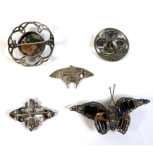99 - A collection of five brooches, comprising an Edwardian Scottish silver butterfly shaped brooch, deco...