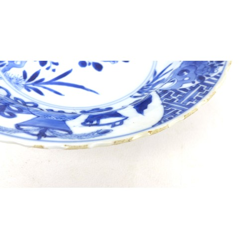5 - A Chinese porcelain bowl, Qing Dynasty, 19th century, bowl, with scalloped rim, decorated in undergl...