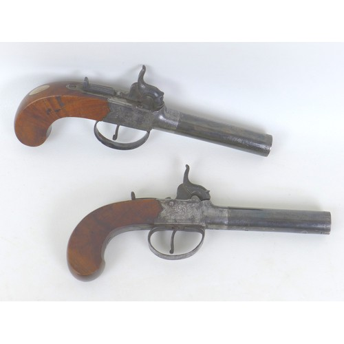 174 - A pair of 19th century boxlock percussion cap pocket pistols, with blued steel circular barrels, eng...