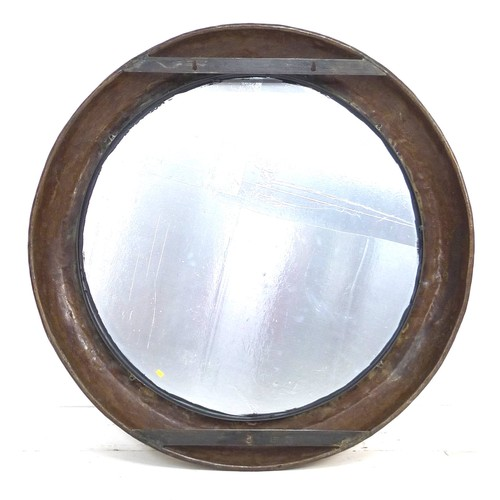 286 - A group of three decorative mirrors, particularly suitable as garden mirrors, comprising a large cir...