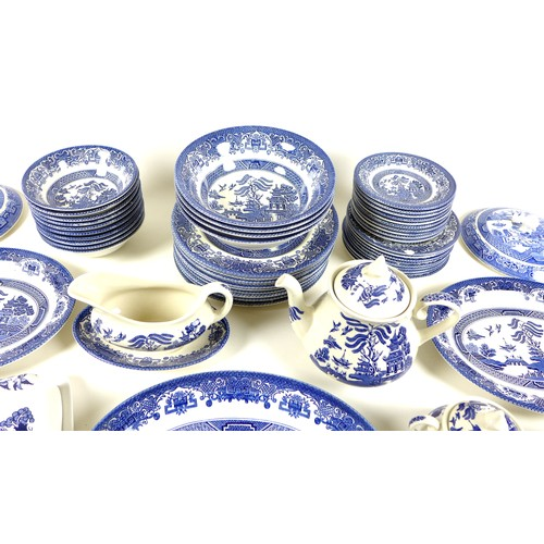 27 - An composite English Ironstone Tableware part dinner service in the Old Willow Pattern, comprising t...