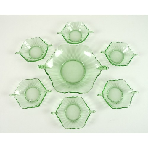 25 - An Art Deco green depression glass bowl, 22 by 30 by 7cm high, with six soup bowls, 12 by 17 by 4cm ...