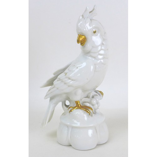 31 - A group of seven continental porcelain and bisque figurines, comprising two porcelain cockatoos, an ...