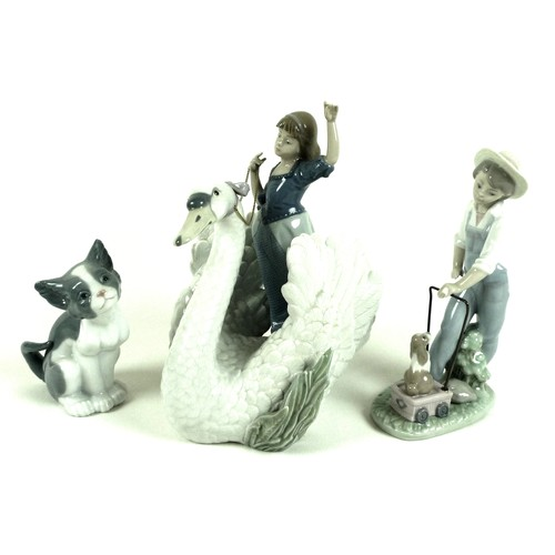 38 - A group of three Lladro figurines, comprising 'The Princess and The Swan', number 5705, 24cm high, S...