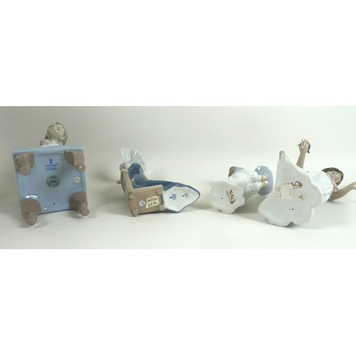 39 - A group of two Lladro and two Nao figurines comprising Lladro: 'Purr-fect Friends', number 6512, 23....