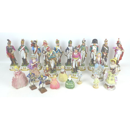 35 - Twelve figurines of soldiers figurines by Capodimonte, in various uniforms and regiments, most appro...