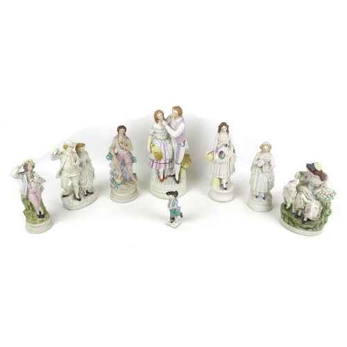 32 - A group of eight bisque and ceramic figurines, including a 19th century Royal Berlin (KPM) factory p...