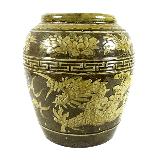 21 - A large Chinese stoneware vase, with relief moulded decoration to the body depicting a dragon chasin...