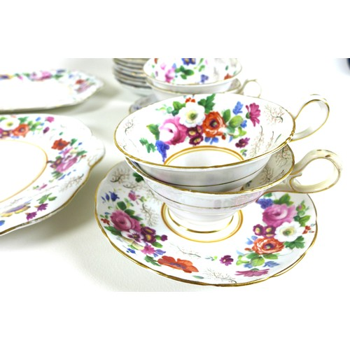 29 - An early 20th century part tea service decorated with roses and garden flowers with gilded highlight...