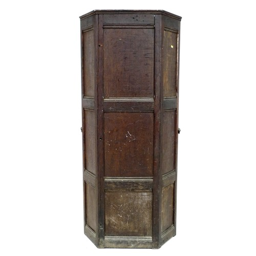 377 - An 18th century oak porter's chair, the high six panel back over a box base, the front panel hinged ...