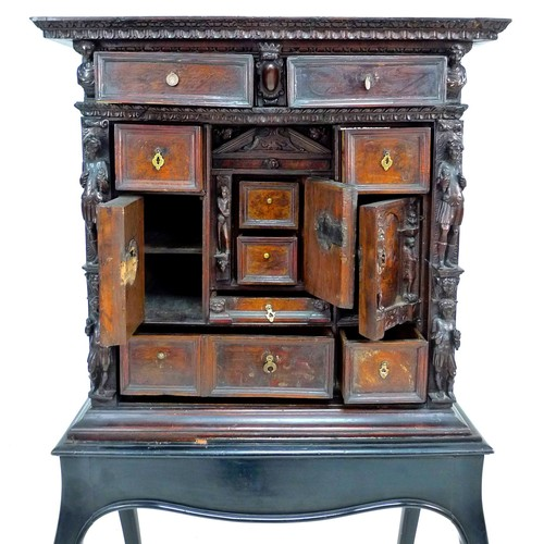 380 - An Italian walnut Renaissance style cabinet, 'Stipo a Bambocci', likely Genoa, 18th century, profuse...