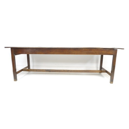 378 - A 18th century oak refectory table, the four plank surface with breadboard ends over a plain frame w...