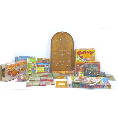 119 - A Bagatelle board with marbles, and a large collection of vintage and retro games for restoration, i...