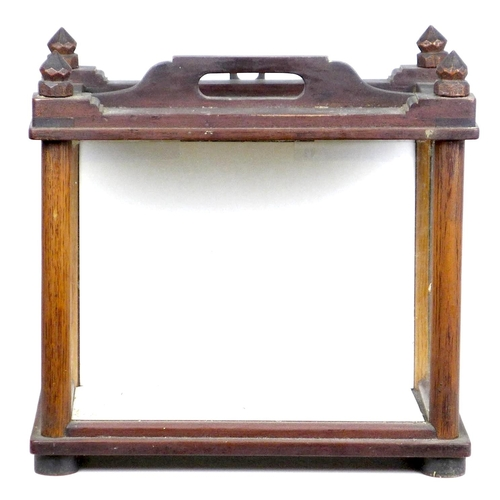 190 - A Victorian mahogany table top display case, with carved finials, single handle to its top, three gl...