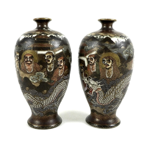 2 - A pair of Japanese Satsuma pottery vases, Meiji period, of ovoid form with flared foot, the ivory co...